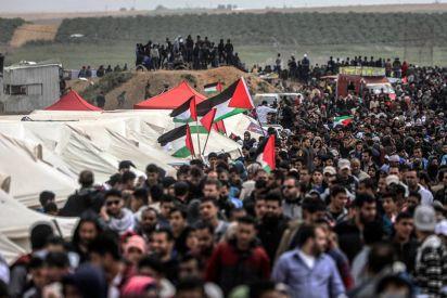 مسيرة العودة الكبرى، غابت الرايات الحزبية وحضر علم فلسطين